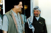 Yasser Arafat and Colonel Gadhafi at Benghazi in 1991