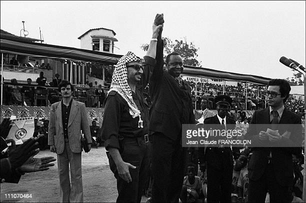 Yasser Arafat and Idi Amin Dada at the stadium in Kampala Uganda on July 29 1975