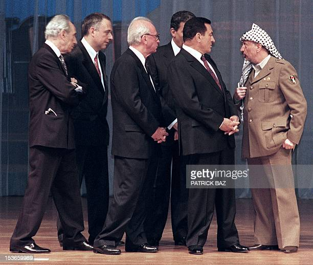 Yasser Arafat President of Palestine Liberation Organisation addresses 04 May 1994 in Cairo Israeli Foreign Minister Shimon Peres Russian Foreign...