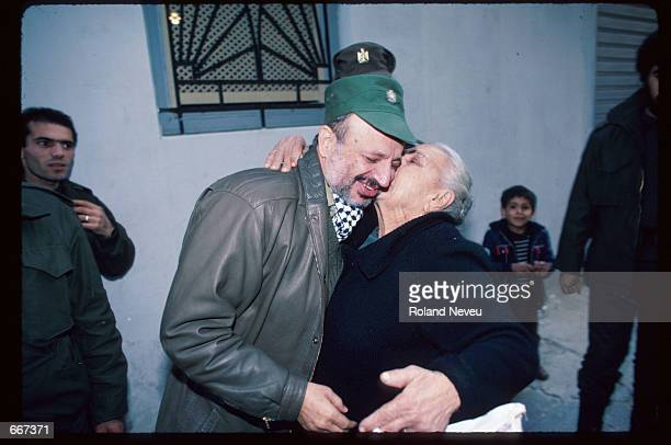 Yasser Arafat receives a kiss from an elderly woman December 19 1983 in Tripoli Lebanon After receiving the Nobel Peace Prize in 1994 Palestine...