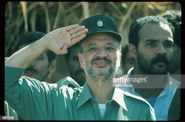 Yasser Arafat salutes October 10 1983 in Tripoli Lebanon After receiving the Nobel Peace Prize in 1994 Palestine Liberation Organization leader...
