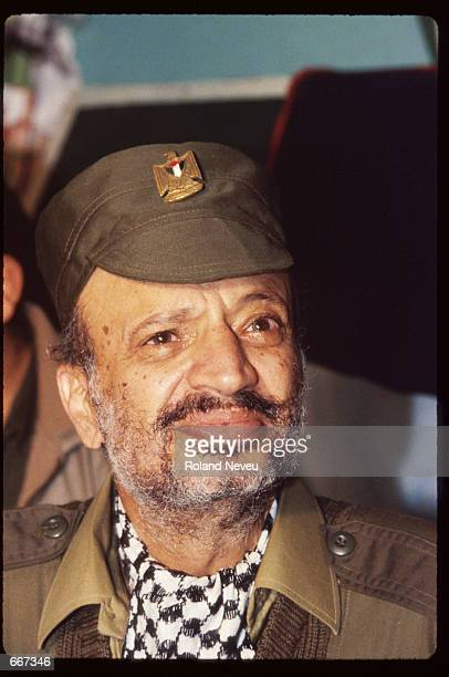 Yasser Arafat stands November 25 1983 in Tripoli Lebanon After receiving the Nobel Peace Prize in 1994 Palestine Liberation Organization leader...