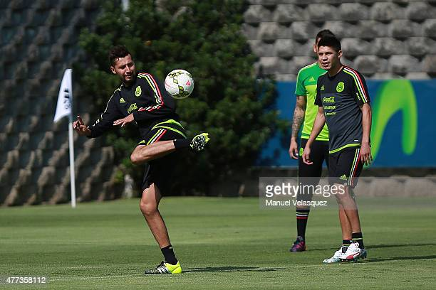Yasser Corona and Oribe Peralta play to control the ball during a Mexico National Team training session prior the beginning of Gold Cup 2015 at CAR...