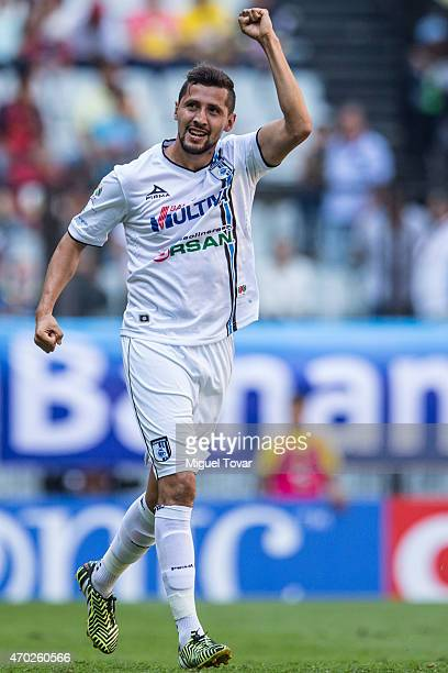 Yasser Corona of Queretaro celebrates after scoring the first goal of his team during a match between America and Queretaro as part of 14th round of...