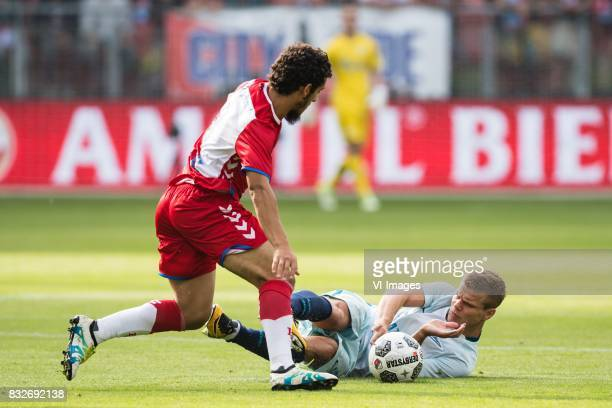 Yassin Ayoub of FC Utrecht Aleksandr Kokorin of FK Zenit St Petersburg during the UEFA Europa League fourth round qualifying first leg match between...