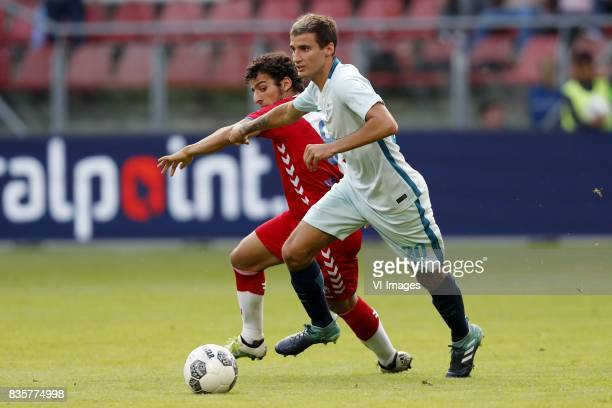 Yassin Ayoub of FC Utrecht Emanuel Mammana of FC Zenit during the UEFA Europa League fourth round qualifying first leg match between FC Utrecht and...