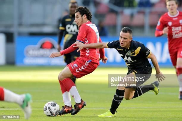 Yassin Ayoub of FC Utrecht Giovanni Korte of NAC Breda during the Dutch Eredivisie match between FC Utrecht v NAC Breda at the Stadium Galgenwaard on...