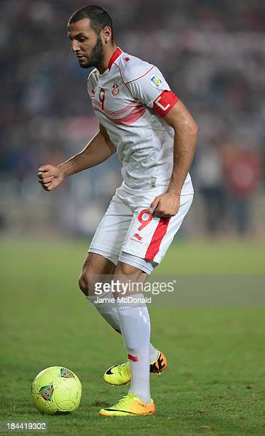 Yassin Chikhaoui of Tunisia in action during the FIFA 2014 World Cup qualifier at the Stade Olympique de Radès on October 13 2013 in Rades Tunisia