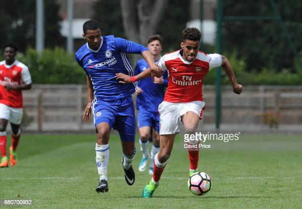 Yassin Fortune of Arsenal takes on Josh Grant of Chelsea during the U18 Premier League match between Chelsea and Arsenal at Chelsea Training Ground...