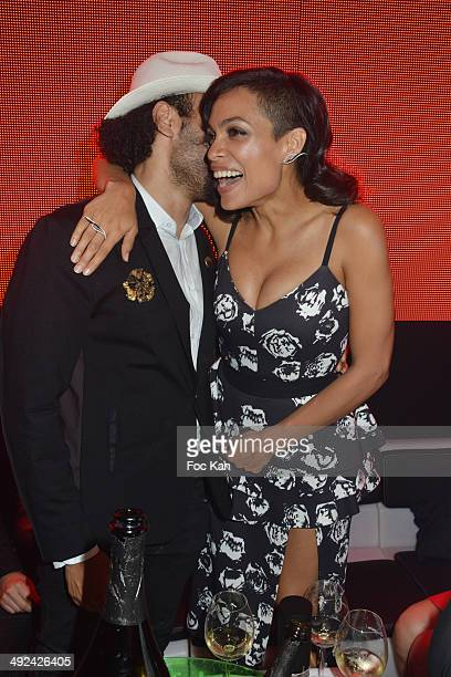 Yassine Azzouz and Rosario Dawson attend the VIP Room JW Marriott Day 6 Dancing Spies Ball hosted by Rosario Dawson 67th Annual Cannes Film Festival...