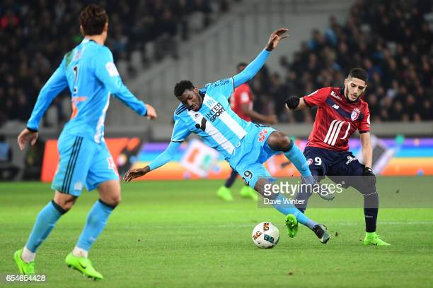 Yassine Benzia of Lille and Andre Franck Zambo Anguissa of Marseille during the Ligue 1 match between Lille OSC and Olympique de Marseille at Stade...