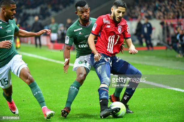 Yassine Benzia of Lille and Habib Maiga of St Etienne during the Ligue 1 match between Lille OSC and AS SaintEtienne at Stade Pierre Mauroy on...