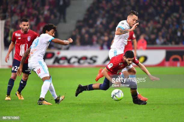 Yassine Benzia of Lille and Lucas Ocampos of Marseille during the Ligue 1 match between Lille OSC and Olympique Marseille at Stade Pierre Mauroy on...