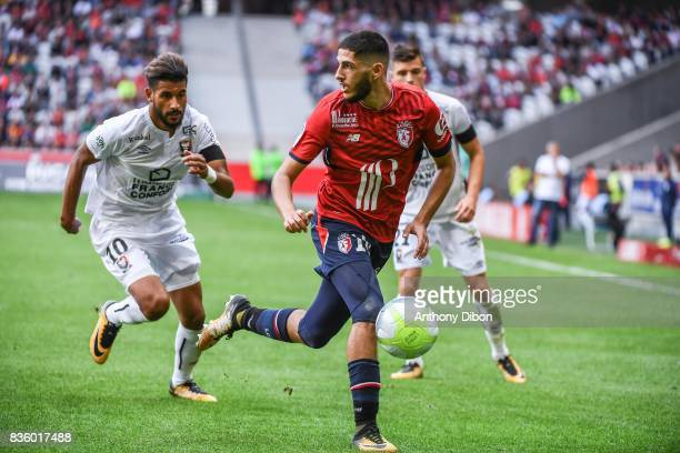 Yassine Benzia of Lille and Youssef Ait Bennasser of Caen during the Ligue 1 match between Lille OSC and SM Caen at Stade Pierre Mauroy on August 20...