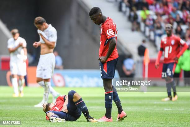 Yassine Benzia of Lille injured during the Ligue 1 match between Lille OSC and SM Caen at Stade Pierre Mauroy on August 20 2017 in Lille