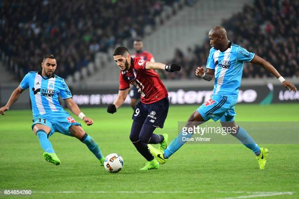 Yassine Benzia of Lille slips between Dimitri Payet of Marseille and Rod Fanni of Marseille during the Ligue 1 match between Lille OSC and Olympique...