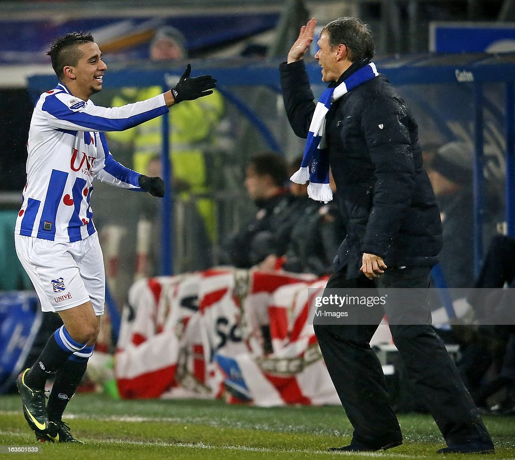 Yassine el Ghanassy of Heerenveen (L), coach Marco van Basten of Heerenveen during the Dutch Eredivisie match between SC Heerenveen and PSV Eindhoven at the Abe Lenstra Stadium on march 09, 2013 in Heerenveen, The Netherlands
