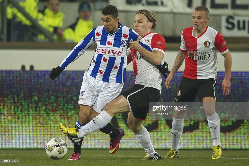 Yassine El Ghanassy of SC Heerenveen, Ruud Vormer of Feyenoord, Jordy Clasie of Feyenoord during the Dutch Eredivisie match between SC Heerenveen and Feyenoord at the Abe Lenstra Stadium on march 30, 2013 in Heerenveen, The Netherlands