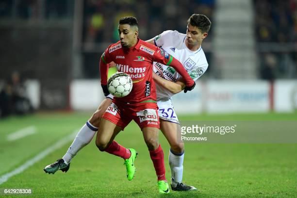 Yasssine El Ghanassy midfielder of KV Oostende is fighting for the ball with Leander Dendoncker midfielder of RSC Anderlecht during the Jupiler Pro...