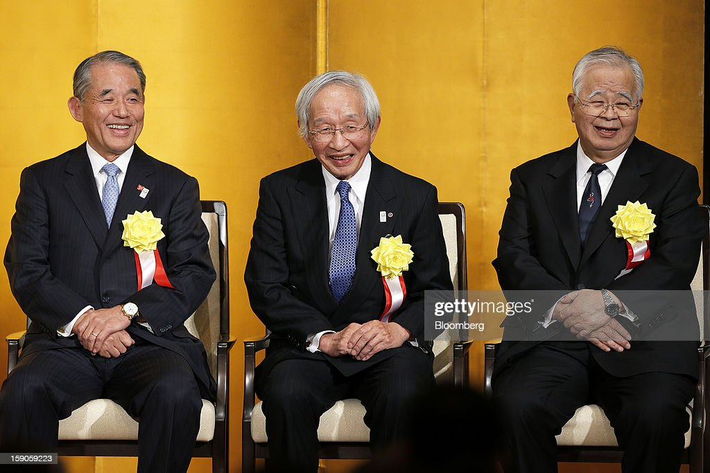 Yasuchika Hasegawa, president of Takeda Pharmaceutical Co. and chairman of the business lobby Keizai Doyukai, from left, Tadashi Okamura, advisor to Toshiba Corp. and chairman of the Japan Chamber of Commerce and Industry (JCCI), and Hiromasa Yonekura, chairman of Sumitomo Chemical Co. and chairman of the business lobby Keidanren, attend a New Year's party for business leaders in Tokyo, Japan, on Monday, Jan. 7, 2013. The Japanese government will announce around 12 trillion yen ($136 billion) in fiscal stimulus measures to boost the nation's shrinking economy, Japanese media reported today. Photographer: Kiyoshi Ota/Bloomberg via Getty Images