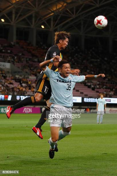 Yasuhiro Hiraoka of Vegalta Sendai and Shun Morishita of Jubilo Iwata compete for the ball during the JLeague J1 match between Vegalta Sendai and...