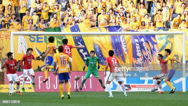 Yasuhiro Hiraoka of Vegalta Sendai and Yuki Abe of Urawa Red Diamonds compete for the ball during the JLeague J1 match between Vegalta Sendai and...