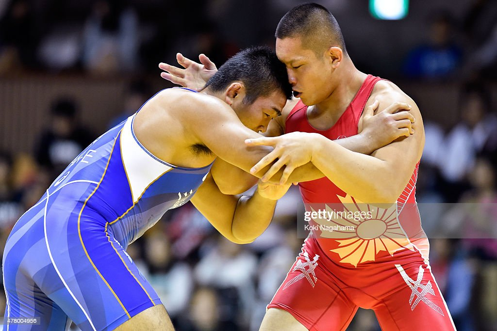 Yasuhiro Yonehira(blue) competes in the Men's 98kg greco-roman style final match against Yusuke Yamamoto (red) during All Japan Wrestling Championships at Yoyogi National Gymnasium on June 21, 2015 in Tokyo, Japan.