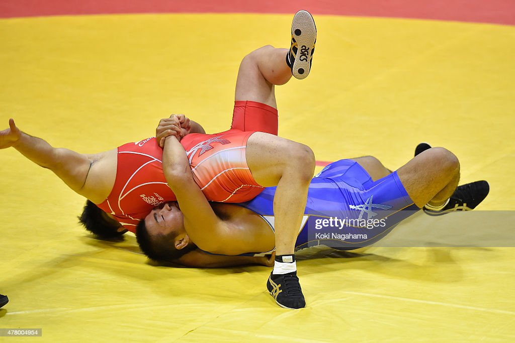 Yasuhiro Yonehira(blue) competes in the Men's 98kg greco-roman style semifinal match against Akira Osaka (red) during All Japan Wrestling Championships at Yoyogi National Gymnasium on June 21, 2015 in Tokyo, Japan.