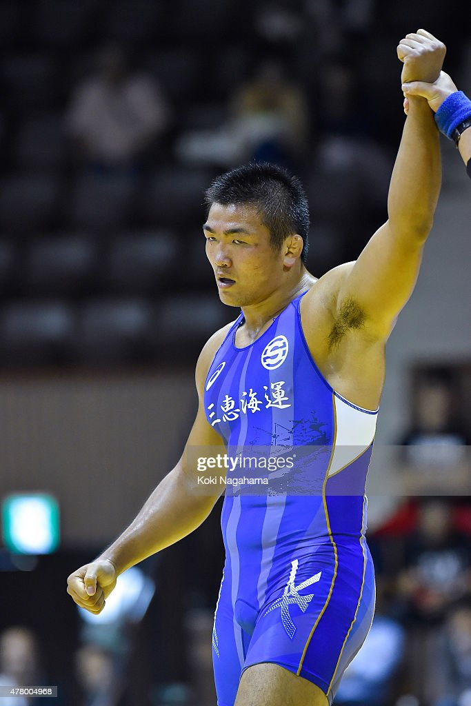Yasuhiro Yonehira(blue) rises his arm after winning the Men's 98kg greco-roman style final match against Yusuke Yamamoto (red) during All Japan Wrestling Championships at Yoyogi National Gymnasium on June 21, 2015 in Tokyo, Japan.