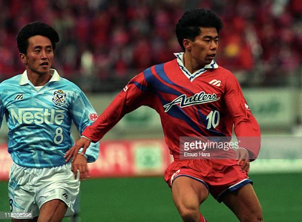 Yasuhiro Yoshida of Kashima Antlers and Hiroyuki Yoshida of Jubilo Iwata compete for the ball during the JLeague Suntory series match between Kashima...