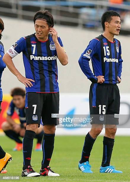 Yasuhito Endo and Yasuyuki Konno of Gamba Osaka react after 11 draw in the JLeague match between Gamba Osaka and Vegalta Sendai at Expo '70...