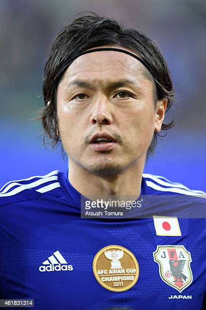 Yasuhito Endo lines up for the national anthem before the 2015 Asian Cup match between Japan and Jordan at AAMI Park on January 20 2015 in Melbourne...