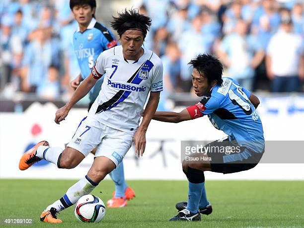 Yasuhito Endo of Gamba Osaka and Kengo Nakamura of Kawasaki Frontale compete for the ball during the JLeague match between Kawasaki Frontale and...
