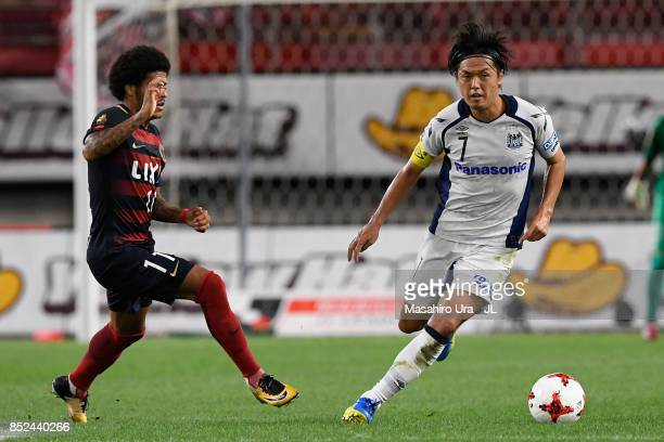 Yasuhito Endo of Gamba Osaka and Leandro of Kashima Antlers compete for the ball during the JLeague J1 match between Kashima Antlers and Gamba Osaka...