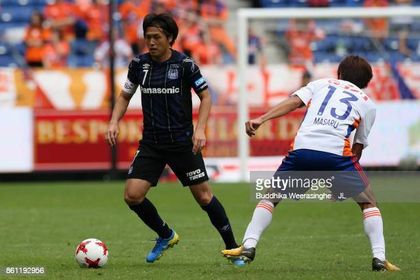 Yasuhito Endo of Gamba Osaka and Masaru Kato of Albirex Niigata compete for the ball during the JLeague J1 match between Gamba Osaka and Albirex...
