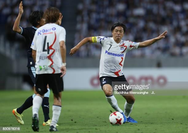 Yasuhito Endo of Gamba Osaka and Shunsuke Nakamura of Jubilo Iwata compete for the ball during the JLeague J1 match between Gamba Osaka and Jubilo...