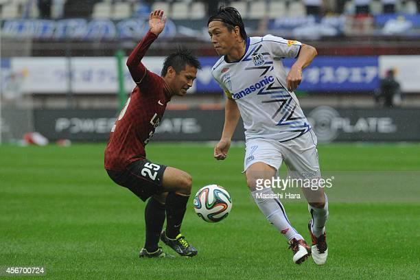 Yasuhito Endo of Gamba Osaka and Yasushi Endo of Kashima Antlers compete for the ball during the JLeague match between Kashima Antlers and Gamba...