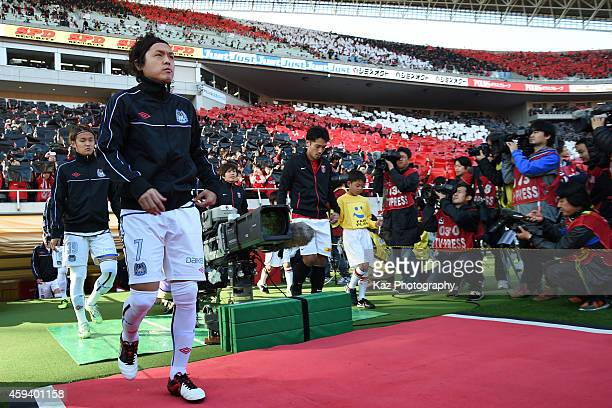 Yasuhito Endo of Gamba Osaka and Yuki Abe of Urawa Red Diamonds lead the players to the pitch for the game during the JLeague match between Urawa Red...