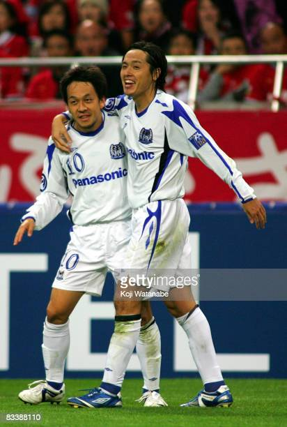 Yasuhito Endo of Gamba Osaka celebrate the third goal with teammate Takahiro Futagawa during the AFC Champions League semifinal second leg match...