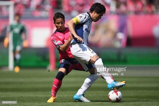 Yasuhito Endo of Gamba Osaka controls the ball under pressure of Riku Matsuda of Cerezo Osaka during the JLeague J1 match between Cerezo Osaka and...