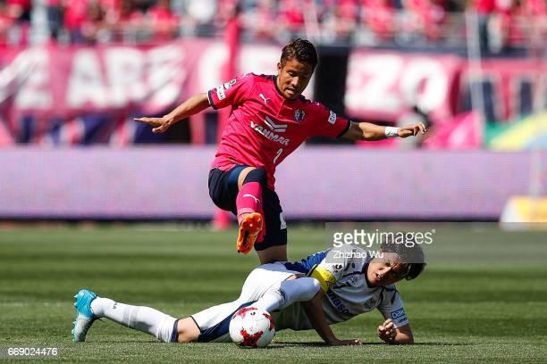 Yasuhito Endo of Gamba Osaka defends against Riku Matsuda of Cerezo Osaka during the JLeague J1 match between Cerezo Osaka and Gamba Osaka at Yanmar...