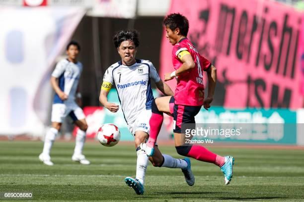 Yasuhito Endo of Gamba Osaka defense Yoichiro Kakitani of Cerezo Osaka during the JLeague J1 match between Cerezo Osaka and Gamba Osaka at Yanmar...