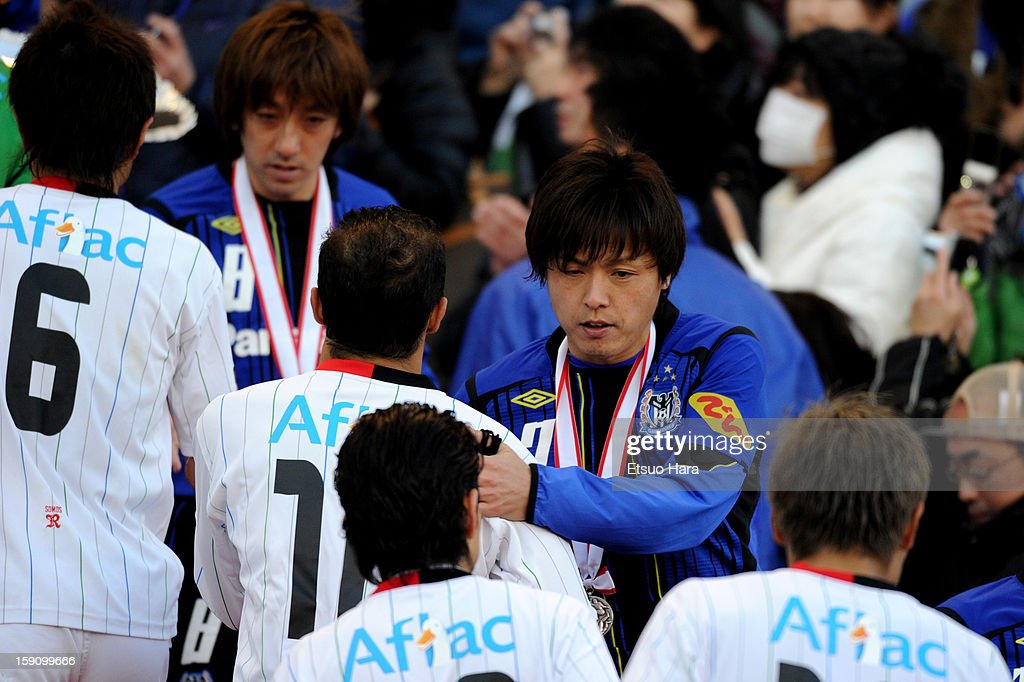 Yasuhito Endo of Gamba Osaka is seen during the award ceremony after the 92nd Emperor's Cup Final match between Gamba Osaka and Kashiwa Reysol at the National Stadium on Janaury 1, 2013 in Tokyo, Japan.