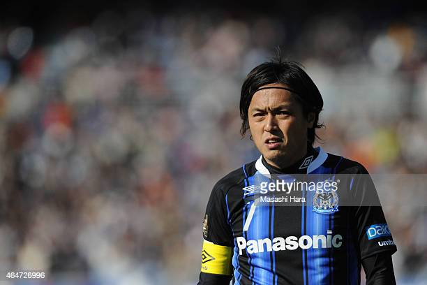 Yasuhito Endo of Gamba Osaka looks on during the FUJI XEROX SUPER CUP 2015 match between Gamba Osaka and Urawa Red Diamonds at Nissan Stadium on...