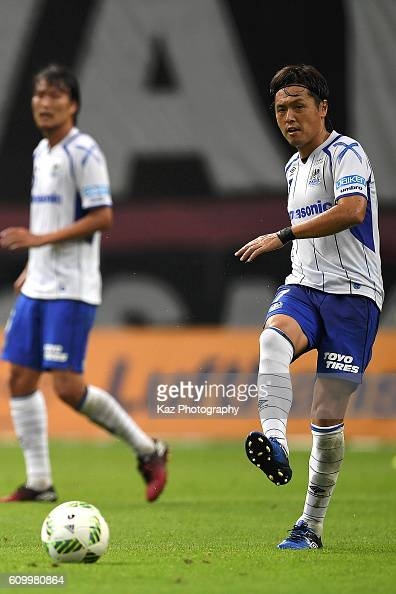 Yasuhito Endo of Gamba Osaka passes the ball during the J League match between Nagoya Grampus and Gamba Osaka at the Toyota Stadium on September 17...