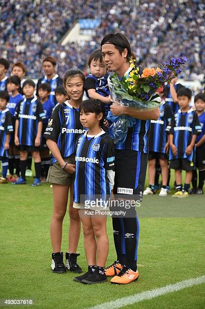 Yasuhito Endo of Gamba Osaka receives the flowers from their children for the 500th game on October 17 2015 in Osaka Japan
