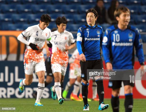 Yasuhito Endo of Gamba Osaka shows his dejection after Jeju United's third goal during the AFC Champions League Group H match between Gamba Osaka and...