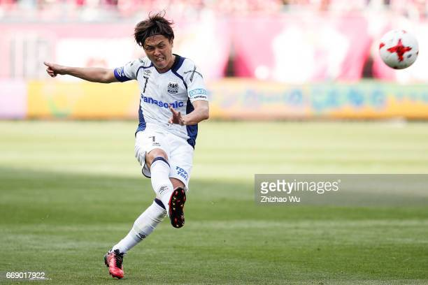 Yasuhito Endo of Gamba Osaka takes a shot during the JLeague J1 match between Cerezo Osaka and Gamba Osaka at Yanmar Stadium on April 16 2017 in...