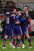 Yasuhito Endo of Japan celebrates his goal with team mates during the international friendly match between Japan and Honduras at Toyota Stadium on...
