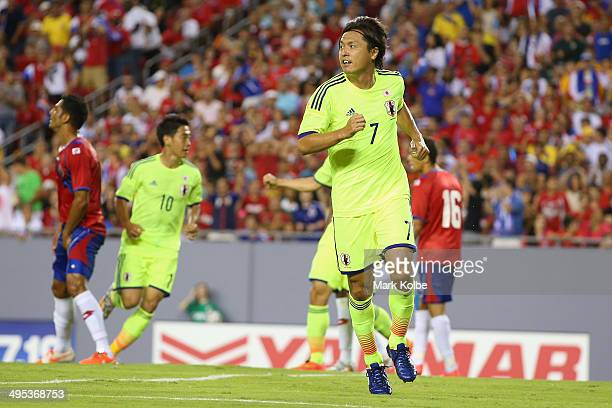 Yasuhito Endo of Japan celebrates scoring a goal during the International Friendly Match between Japan and Costa Rica at Raymond James Stadium on...